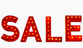 Red Sale Sign. Lit Up Sale Sign isolated on white background Stock Images