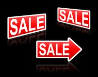 Sale signs. Red sale signs on the black background Stock Image