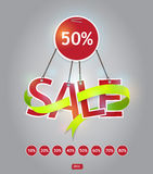 Red sale text hanging with green ribbon. Royalty Free Stock Image