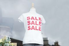Red sale white t-shirt on female mannequin in shop window. Shopping mall uk Royalty Free Stock Image
