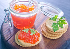 Red salmon caviar. In bank and on a table Royalty Free Stock Photo