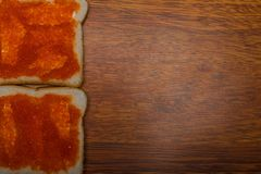 Red salmon caviar on bread with butter. Omega 3. Red salmon caviar on bread toast. Sandwich. Omega 3 Stock Photography