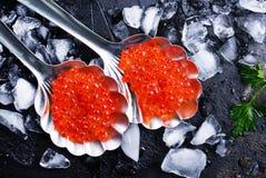 Caviar. Red salmon caviar, salmon caviar in metal spoons royalty free stock images