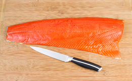 Red Salmon with Cutting Knife on Board Royalty Free Stock Photo
