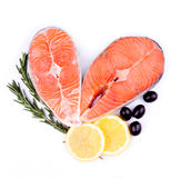 Red salmon fish. Fresh red salmon fish steak with rosemary lemon and olives Stock Image