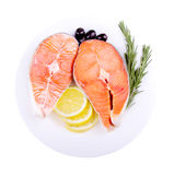 Red salmon fish. Fresh red salmon fish steak with rosemary lemon and olives Stock Photography