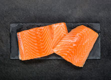 Red Salmon Fish Fillet Raw on black board Royalty Free Stock Photography