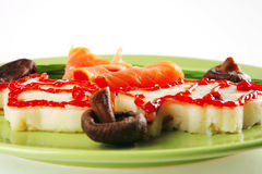 Red salmon with mash on green Royalty Free Stock Photography