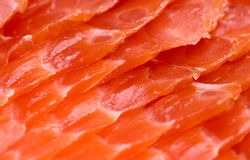Red salmon slices close-up Stock Images