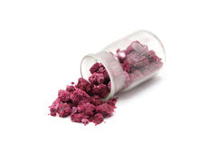 Red salt sprinkled from a glass bottle Royalty Free Stock Photography