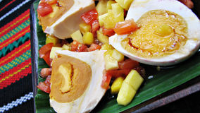Red Salted Egg Salad Asian Delicacy. On a Native Table royalty free stock image