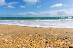 Red sand and blue sea of Cable Bay Northland New Zealand. Blue sky above scenic red sand and blue sea of Cable Bay Northland New Zealand Royalty Free Stock Photography