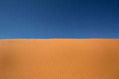Red sand and blue sky Stock Photo