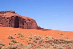 Red Sand Butte. Vista of red sand eroded from butte in background Royalty Free Stock Photos