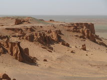 Red sand cliffs Stock Images