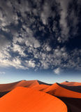 Red sand dune, Sossusvlei, Namibia. Red sand dune with clouds, Dune 45, Sossusvlei, Namibia Royalty Free Stock Photo