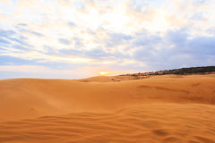Red sand dune and sunset Stock Photos