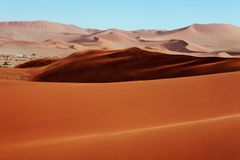 Red sand dunes. As far as the eye can see royalty free stock image