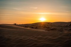 The red sand dunes in Mui ne, Vietnam is popular travel destination with long coastline stock photo