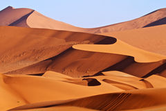 Red sand dunes of Namibia. Red sand dunes of the Namibian desert Stock Images