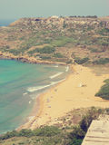 Red sand Ramla beach on Gozo island, Malta, on a sunny day; faded, retro style Royalty Free Stock Image