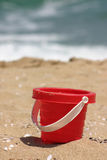 Red Sand Toy on the Beach. Red toy bucket on beach stock images