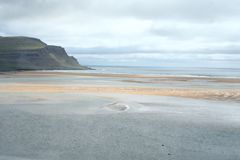Red sand in western fjords in Iceland. Red sand in the West fjords in Iceland. Beautiful beach where the color division is unique. Beautiful nature stock photos