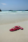 Red sandal story. Red sandal on the Koh Lan beach Royalty Free Stock Photography