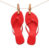 Red sandals hanging on a pin on a rope Royalty Free Stock Image