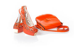 Red sandals and red leather handbag. Isolated Royalty Free Stock Images