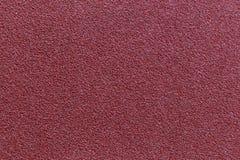 Red sandpaper texture background for design. Red sandpaper texture background for industrial construction concept design stock photo