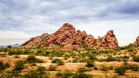 The red sandstone buttes of Papago Park near Phoenix Arizona. The red sandstone buttes of Papago Park, with its many caves and crevasses caused by erosion under Stock Images