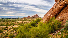 The red sandstone buttes of Papago Park near Phoenix Arizona. The red sandstone buttes of Papago Park, with its many caves and crevasses caused by erosion under Stock Photography