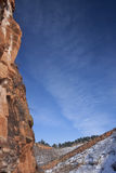 Red sandstone cliff and blue sky Stock Image