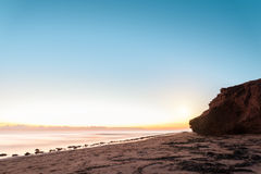 Red sandstone cliffs at sunrise Royalty Free Stock Photography