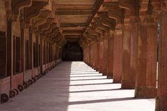 Red Sandstone Colonnade. Long sandstone colonnade in Fatehpur Sikri, Agra, India Royalty Free Stock Photos