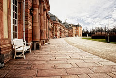 Red sandstone palace walkway with row of smooth columns. Stock Images