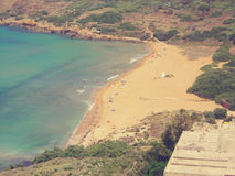Red sandy Ramla beach on Gozo island, Malta, on a sunny day; faded, retro style Stock Images