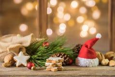 Red Santa cap and christmas cookies Stock Image