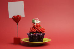 Red Santa Christmas festive cupcake with place car Royalty Free Stock Image