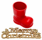 Red Santa Claus boot, shoe with Merry Christmas write, letters isolated,  white background. Stock Images