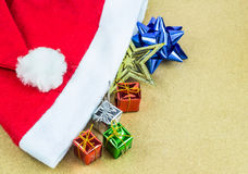 Red Santa Claus hat and gift box on wooden background Royalty Free Stock Photography