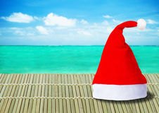 Red Santa Claus hat on ocean background Royalty Free Stock Photos