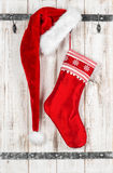 Red Santa Claus hat and sock for gifts. Christmas decoration Royalty Free Stock Photo