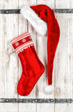 Red Santa Claus hat and sock for gifts. Christmas decoration Stock Images