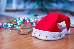 Red Santa Claus hat on a timber floor with Stock Photo