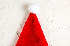 Red Santa Claus hat top view, christmas decoration, greeting card concept with space for text. Santa hat and fir tree branches. Christmas composition. Top view royalty free stock photography