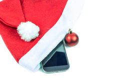 Red Santa Claus hat on a white background Stock Images