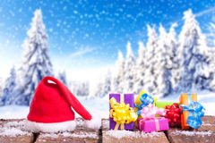 Red santa claus hat in winter landscape Stock Photography