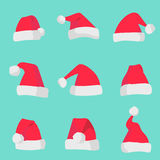 Red Santa Claus hats isolated on colorful background. Symbol of Christmas holiday. Vector santa hat set. Stock Photo